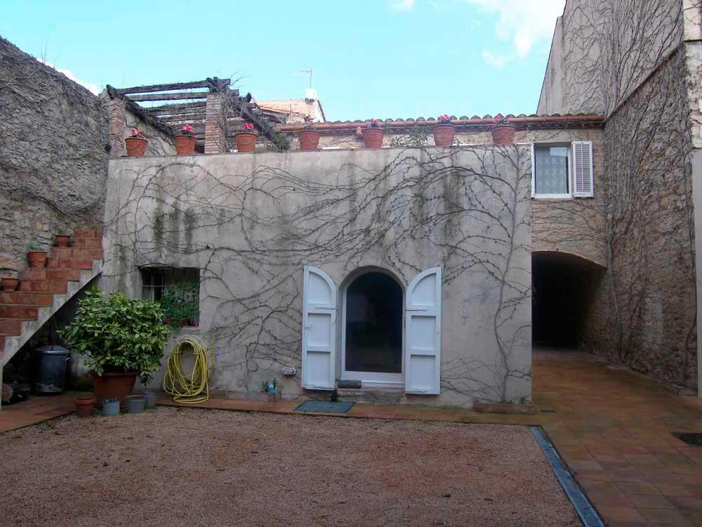 Restored stone house in the center of the village of Peratallada (Costa Brava)